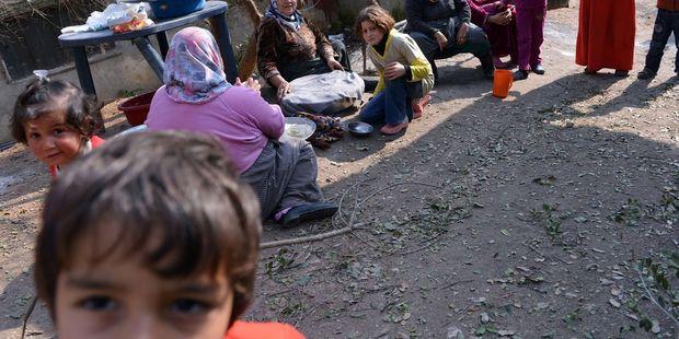 Une famille de déplacés syriens le 25 janvier 2013. | AFP/AAMIR QURESHI