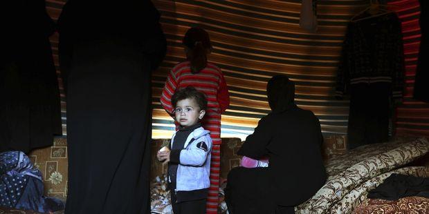 Une famille de déplacés de l'intérieur syriens près de Damas, le 29 janvier 2013. | Reuters/GORAN TOMASEVIC